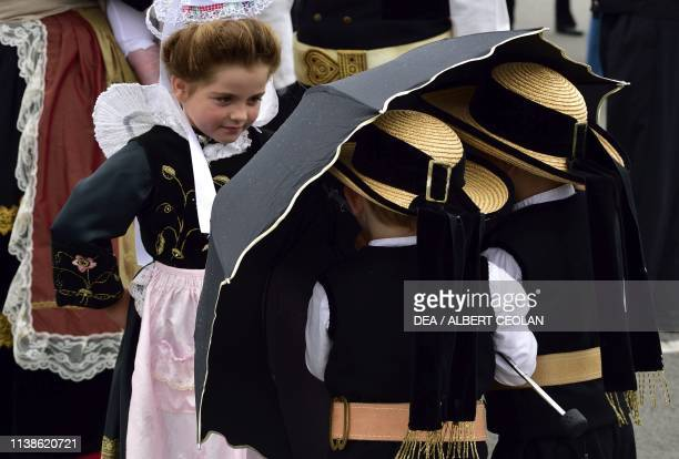 Boys and girls wearing traditional costumes with lace headdresses Festival of Blue Nets Concarneau Brittany France