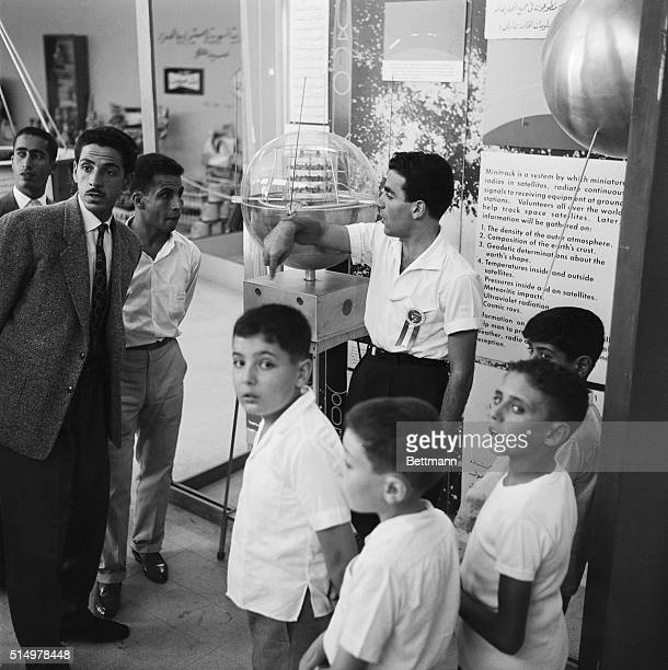 Boys and men visiting a science display at the Damascus International Fairgrounds in Syria