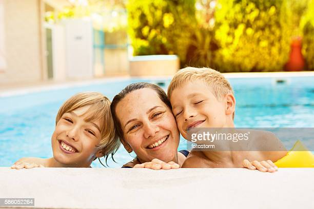 Boys and their mother in the swimming pool