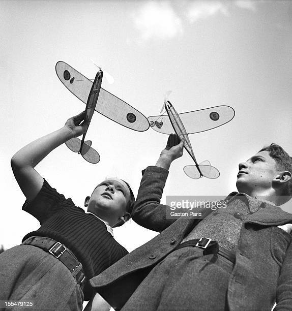 Boys and their toy airplanes France 1940's