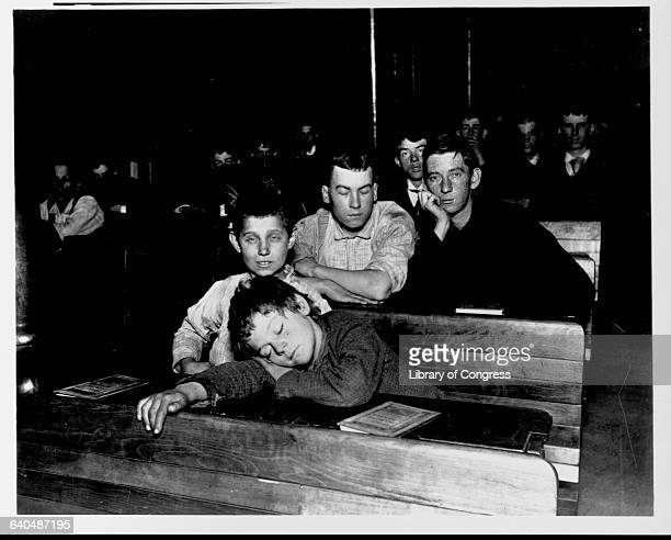Boys and young men attend night school at the Children's Aid Society's Seventh Avenue lodging house