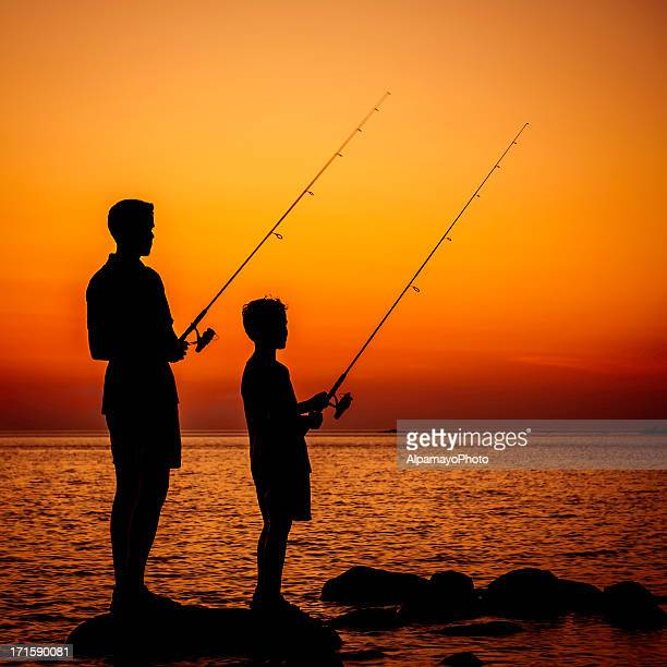 Boys Are Fishing At Sunset - V