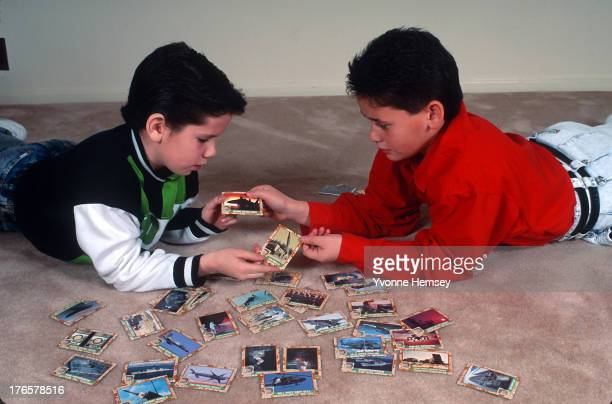 Boys are photographed playing with Desert Storm baseball cards February 12 1991 in New York City Desert Storm trading cards are sets of cards...