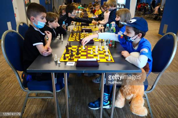Boys are playing chess during coronavirus pandemic at Junior Speed Chess Championship in Krakow, Poland on November 21, 2020.
