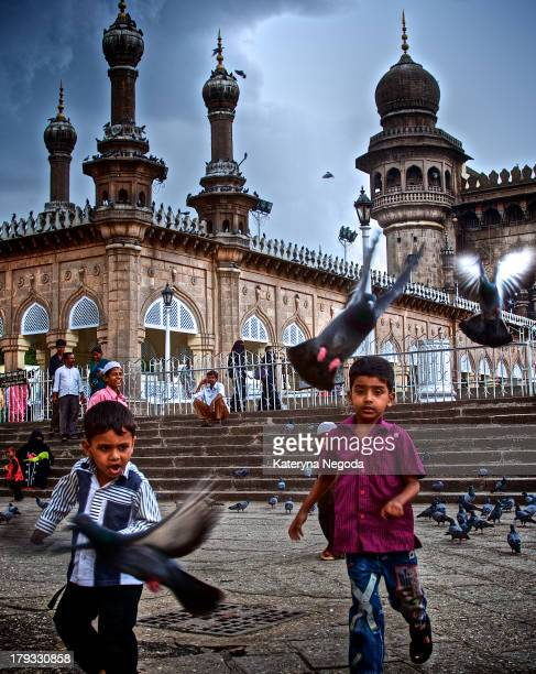 CONTENT] Boys are playing with pigeons by Mecca Masjid in Hyderabad India Mecca Masjid also Makkah Masjid is one of the oldest mosques in Hyderabad...