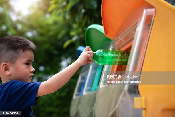 boys are throwing garbage,recycle concept - bin stock pictures, royalty-free photos & images