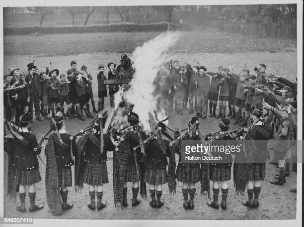 Boys at a Dr Barnados home in Kingston watch as their guy is burned on a bonfire whilst Scottish pipers play a lament   Location Kingston Surrey...