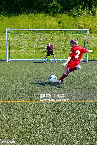 Boys at soccer training, exercising penalty kick, Munich, Bavaria, Germany