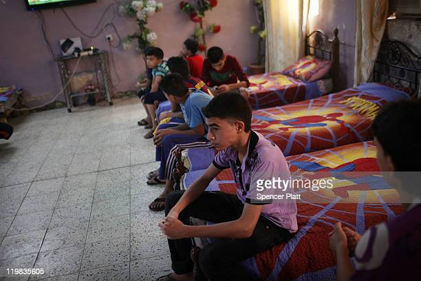 Boys at the Al-Baraum orphanage sit in their room on July 25, 2011 in Baghdad, Iraq. The state owned orphanage has about 50 children currently with...