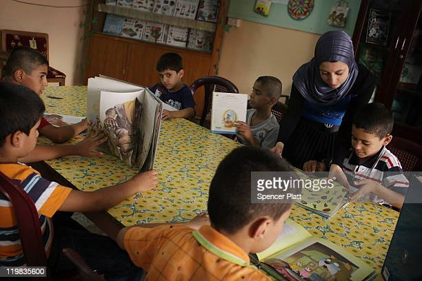Boys attend a reading class at the Al-Baraum orphanage on July 25, 2011 in Baghdad, Iraq. The state owned orphanage has about 50 children currently...