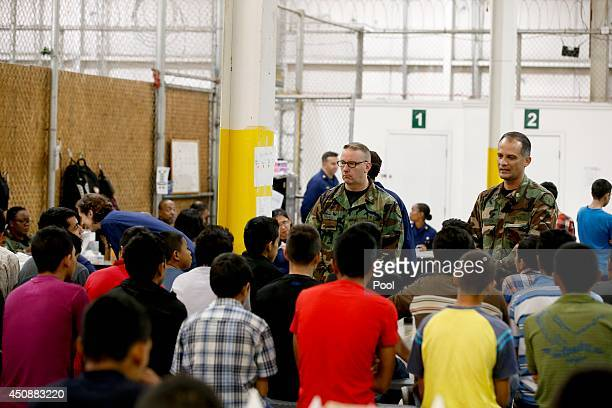 Boys await medical appointments in a holding area where hundreds of mostly Central American immigrant children are being processed and held at the US...