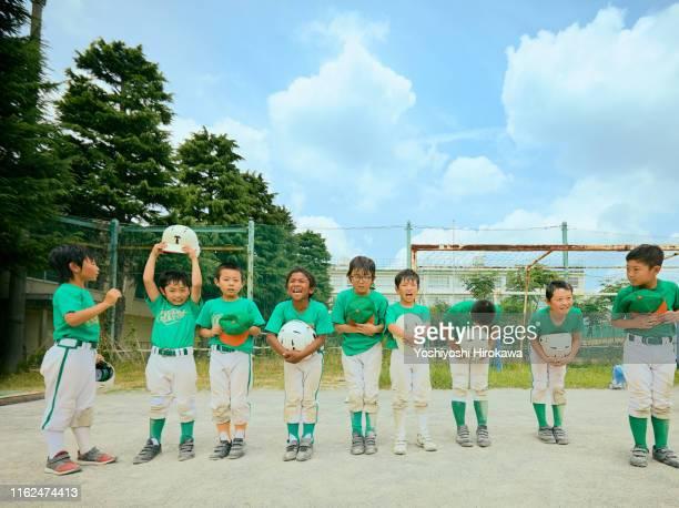 boys baseball players giving a cheerful greeting - 教育関係 ストックフォトと画像