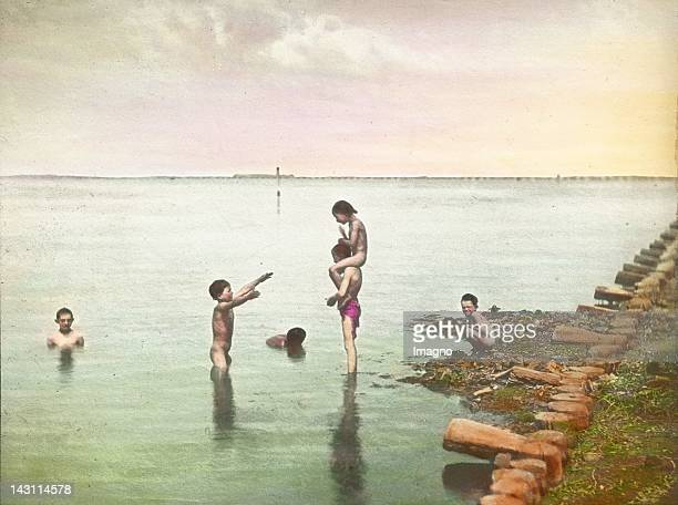 Boys bathing in the lagoons Venice Italy Handcolored lantern slide Around 1910