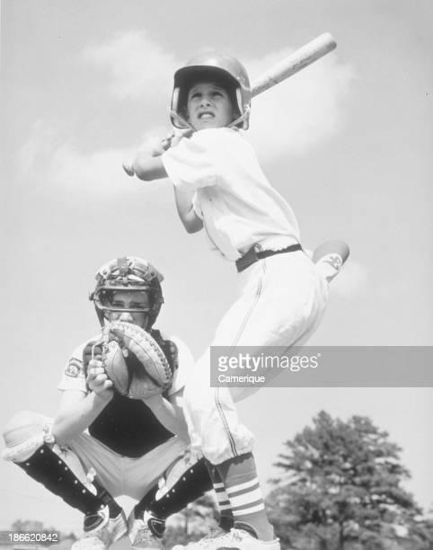 2 Boys batter and catcher playing baseball September 26 1964