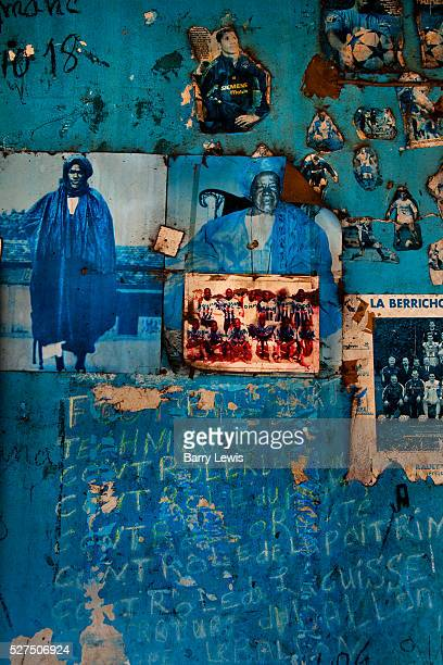Boys bedroom wall with the founder of Mouridism Cheikh Ahmadou Bamba considered one of the greatest spiritual leaders in Senegalese history is...