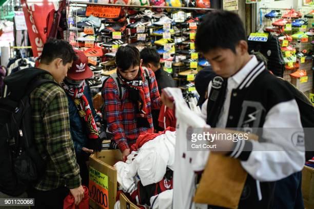Boys browse clothing on sale at a discount stall in Ameya Yokocho market on January 4 2018 in Tokyo Japan Ameya Yokocho claimed to be Tokyo's last...