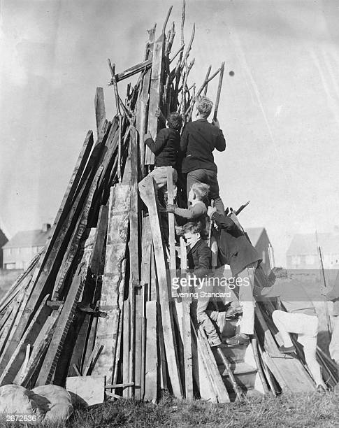 Boys building a bonfire on the downs near Lewes in Sussex in preparation for Guy Fawkes night on the 5th November
