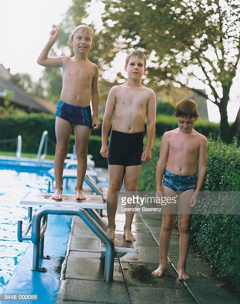 boys by pool - leander licht stock-fotos und bilder