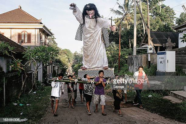 Boys carries the Ogoh-ogoh statue to the temple for procession before paraded this afternoon on March 11, 2013 in Tunjuk Village, Tabanan, Bali,...