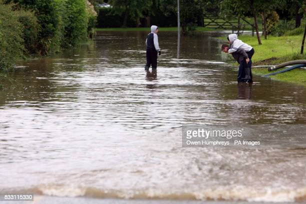 Boys carry each other through a flooded street near Beverley in North East Yorkshire as heavy downpours brought disruption to many areas