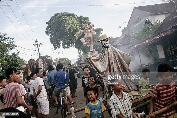 Boys carry the Ogoh-ogohs statues to the temple for procession before paraded this afternoon on March 11, 2013 in Tunjuk Village, Tabanan, Bali,...