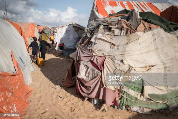 Boys carrying jerrycan with water Somalia in the grip of an unprecedent and devastating food crisis Drought has caused crops to fail and cattle to...