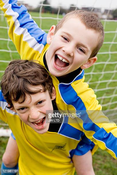boys celebrating in football goal - scoring a goal stock pictures, royalty-free photos & images