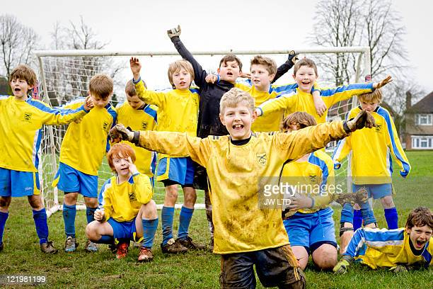 Boys celebrating in football goal