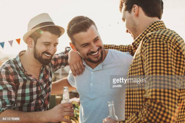 Boys chatting over beer
