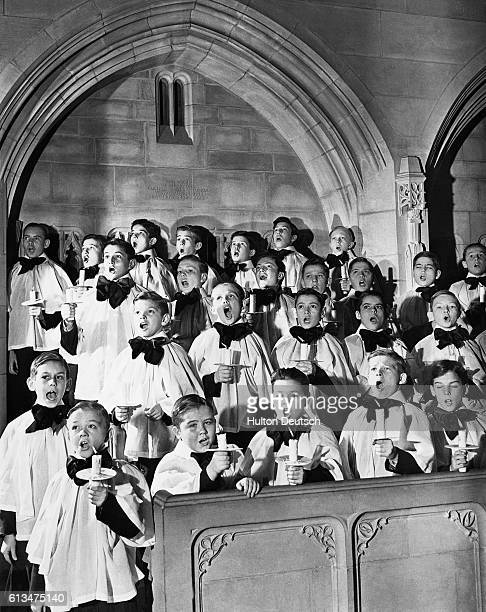 A boys' choir at the Church of the Heavenly Rest in New York City sings Christmas carols in a dress rehearsal for the Christmas Day service in 1940