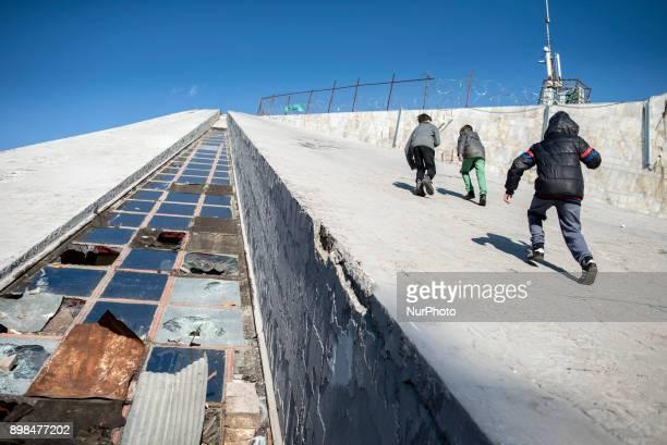 Boys climb up the Pyramid of Tirana Tirana Albania on December 23 2017