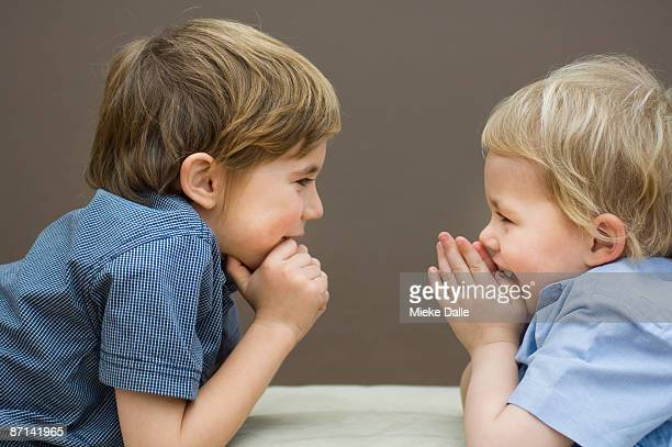 2 boys communicating - 2 5 months stock photos and pictures