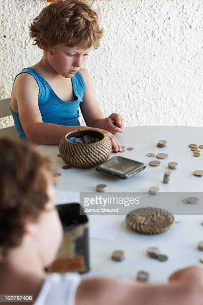 Boys counting coins