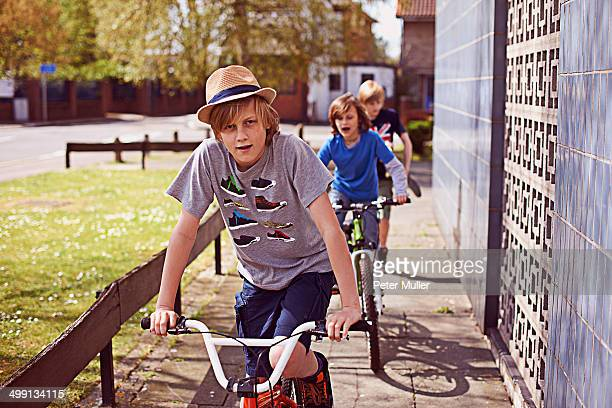 Boys cycling on pavement