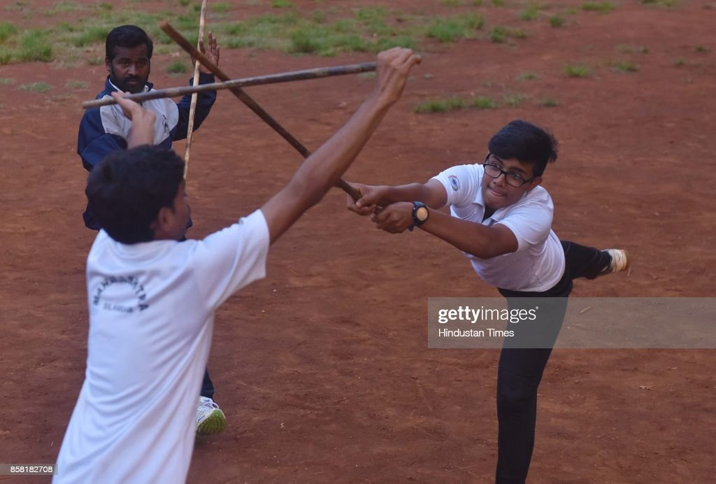 Boys display Stick Fight, a type of Silambam, a weapon based Indian Martial arts, on October 4, 2017 in Pune, India. The word Silambam means either a mountain or merely to sound (as verb). While the Silambam fencers are fighting, the weapon makes sound. This might have been the cause for its being named as Silambam.