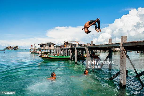 boys diving into clear blue sea, semporna, malaysia - sabah state stock pictures, royalty-free photos & images