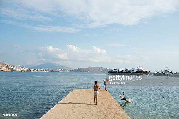 Boys diving into sea in Sarande, Albania