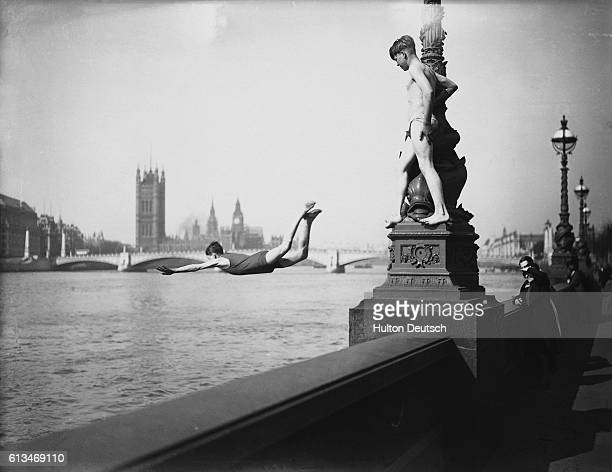 Boys diving into The Thames from the Embankment during an April heatwave in London 1933