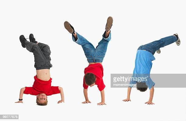 boys doing gymnastics - school gymnastics stock photos and pictures