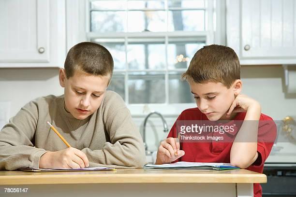 Boys doing homework in kitchen