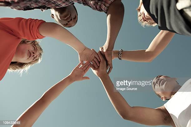 Boys doing huddle, low angle view