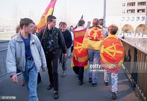 boys draped in east german flags - east germany stock pictures, royalty-free photos & images