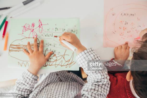 boys drawing at home - coloring stock pictures, royalty-free photos & images