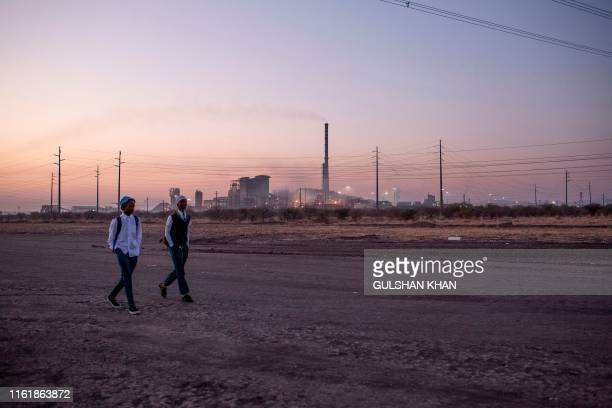 Boys dressed in school uniform walk passed the former Lonmin owned mine, now controlled by Sibanye Stillwater, in Marikana, Rustenberg, close to...