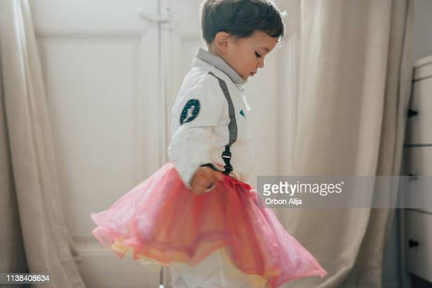 boys dressing up and dancing - dress stock pictures, royalty-free photos & images