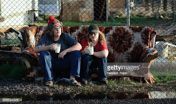 Boys Drinking Milk on a Discarded Couch