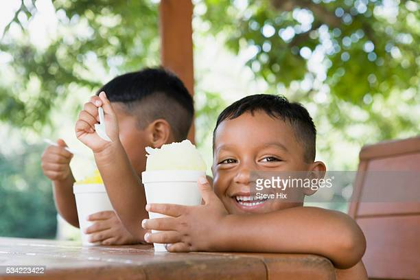 Boys eating granitas