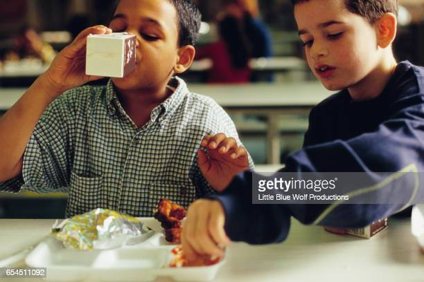 Boys Eating Lunch in Cafeteria