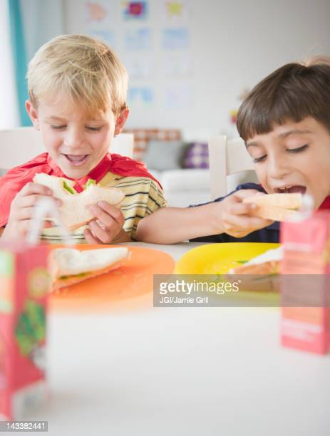 Boys eating lunch together