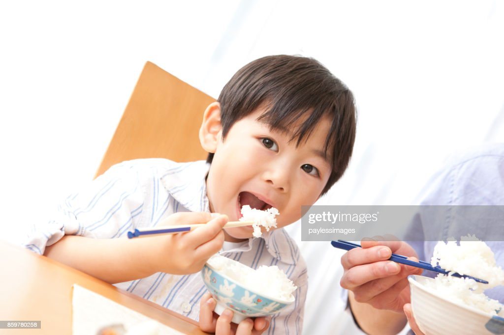 Boys eating : Stock Photo
